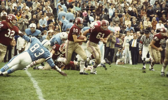 Harvard's Tommy Lee Jones, number 61, leads the way on this run.